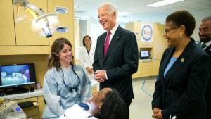 Vice President Joe Biden shares a joke as he visits the dental hygiene program at West Los Angeles College in Culver City, Calif., on Jan. 23, 2015. The Vice President is in town to host a roundtable focusing on the importance of helping more Americans go to college and the critical role that partnerships between community colleges and employers can play in helping Americans obtain the skills they need to succeed in the workforce. (AP Photo/Los Angeles Times, Marcus Yam, Pool)