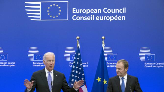U.S. Vice President Joe Biden (L) holds a joint statement with European Council President Donald Tusk ahead of a meeting at EU Council headquarters in Brussels February 6, 2015. Biden said on Friday that the United States and Europe needed to stand together over Ukraine and accused Russian President Vladimir Putin of calling for peace while rolling his troops through Ukrainian countryside. REUTERS/Yves Herman