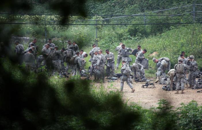 U.S Army soldiers prepare to attend a military exercise in Pocheon, south of the demilitarized zone that divides the two Koreas, South Korea, Friday, Aug. 21, 2015. North Korean leader Kim Jong Un on Friday declared his frontline troops in a