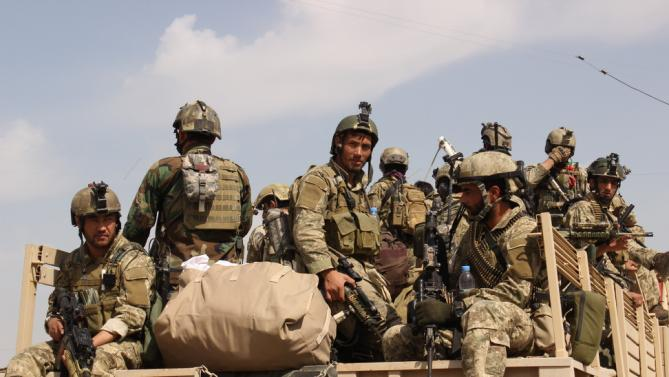 Afghan special forces prepare to launch operation to retake the city from Taliban insurgents in Kunduz, Afghanistan, Sept. 29, 2015. Afghan security forces launched counter-offensive on Tuesday morning to retake the northern Kunduz city and expel Taliban militants from the area, Kunduz police spokesman Sayed Sarwar Hussaini said. (Najim Rahim/Xinhua Press/Corbis)