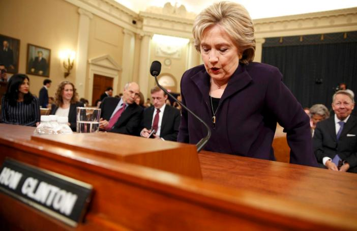 Democratic presidential candidate and former Secretary of State Hillary Clinton takes her seat to resume testifying before the House Select Committee on Benghazi, on Capitol Hill in Washington October 22, 2015. The congressional committee is investigating the deadly 2012 attack on the U.S. diplomatic mission in Benghazi, Libya, when Clinton was the secretary of state.         REUTERS/Jonathan Ernst