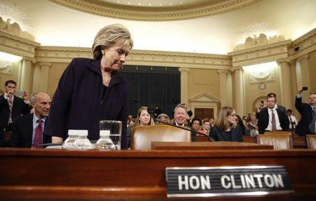 Democratic presidential candidate Hillary Clinton takes her seat to testify in front of the House Select Committee on Benghazi about the attack on a U.S. diplomatic mission in Benghazi, Libya, on Capitol Hill in Washington October 22, 2015. REUTERS/Jonathan Ernst