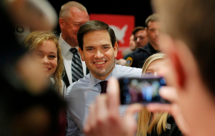 US Republican presidential candidate Marco Rubio poses with attendees in Cedar Falls