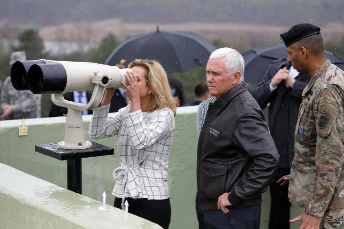 U.S. Vice President Mike Pence stands next to her daughter looking toward the north through a pair of binocular from an observation post inside the demilitarized zone separating the two Koreas, in Paju